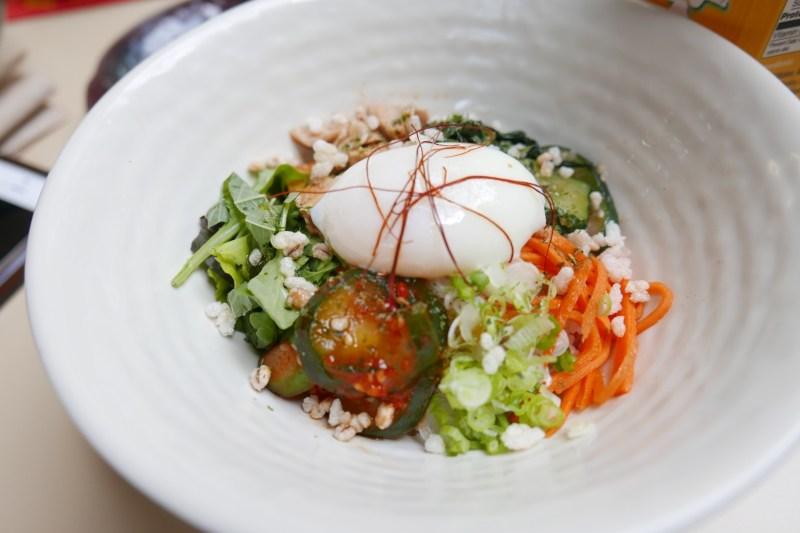 Bibimbap. Barley rice, gochujang sauce, vegetables, chicken, egg, nori