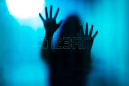 48188061-abstract-woman-behind-the-matte-glass-blurry-hand-and-body-figure