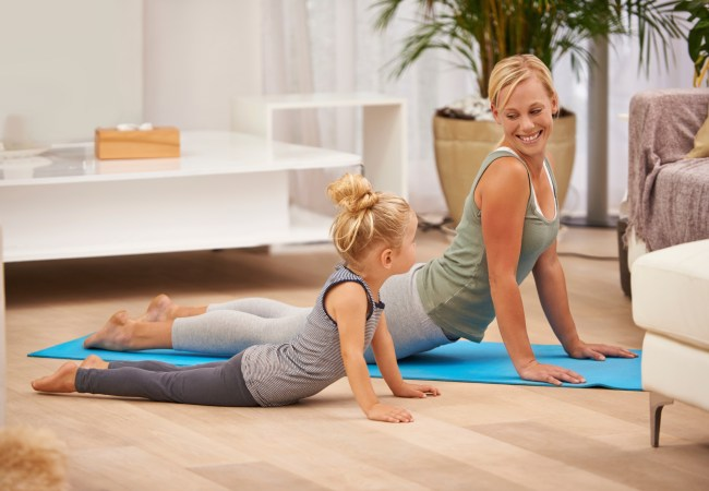 Full length shot of a mother and daughter doing yoga together