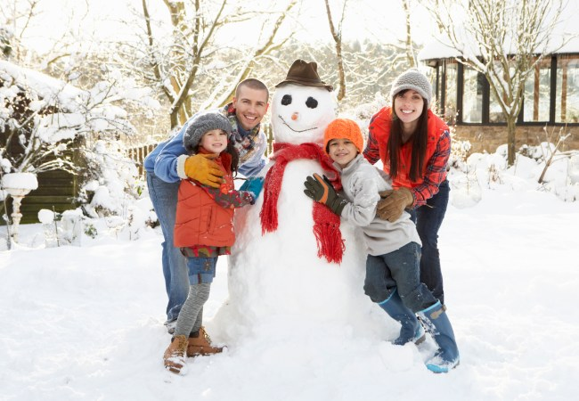 Family building snow man