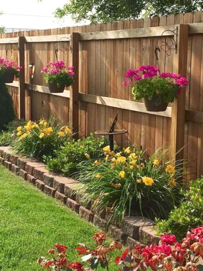 Beautiful Garden Fence Decorating Ideas To Follow 15