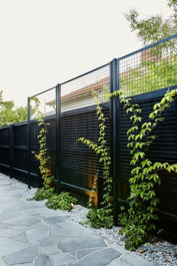 Beautiful Garden Fence Decorating Ideas To Follow 18