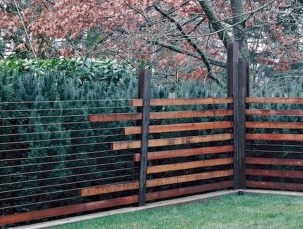 Beautiful Garden Fence Decorating Ideas To Follow 32