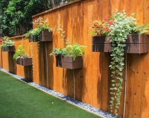 Beautiful Garden Fence Decorating Ideas To Follow 34