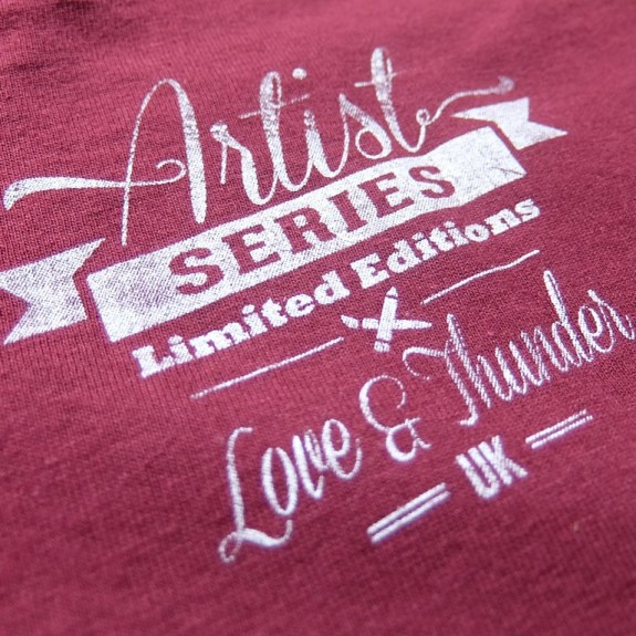 artist series logo on maroon