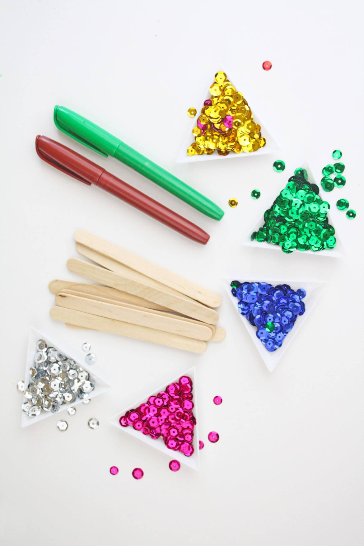 Learn how to make this easy and fun Popsicle Stick Christmas Tree Craft on Love the Day! It's the perfect craft to make with kids this holiday season.