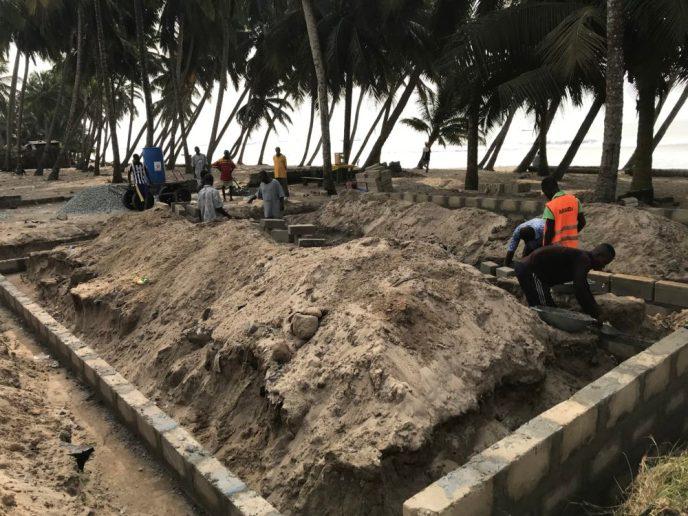 Building foundation walls for public washroom to help end open defecation in Saltpond, Ghana