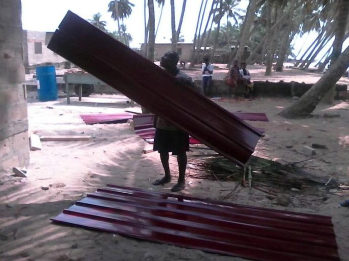 Moving roofing sheets for Love Africa Project public washroom to help end open defecation in Saltpond, Ghana