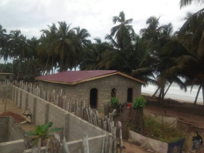 The roof is finished on 20-toilet public washroom construction in Saltpond, Ghana