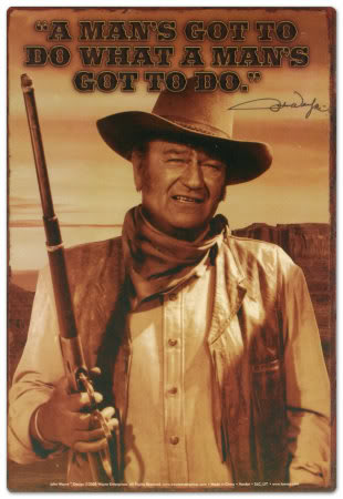 "John Wayne - one of the most famous of the old Wild West ""gun slingers."""