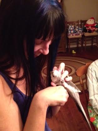 Pearl helps his mommy celebrate her birthday with her favorite gift - neck feather scratches!