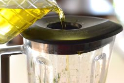 After pulsing a few times, turn blender on low and slowly add oil.