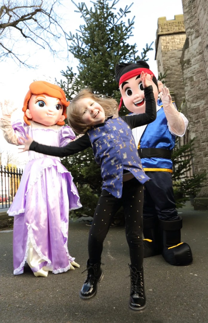 Jumping for joy!  Little Amélie Gibney can barely contain her excitement at meeting popular Disney characters Sofia the First and Jake