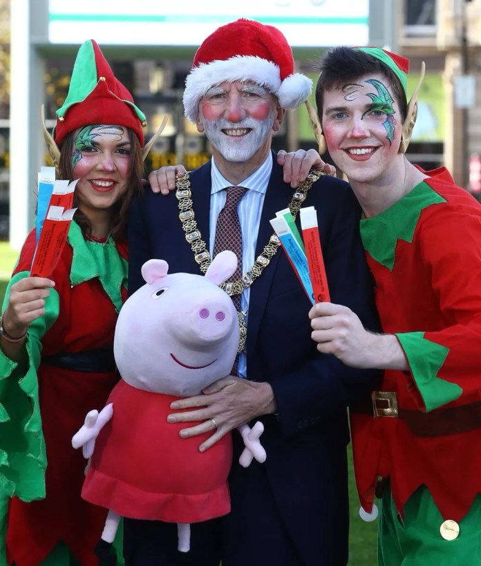 Lord Mayor Mairtin O Muilleoir joins Belfast City Council's elves (Amy Pue and Michael McGroarty) for the launch of this year's Christmas celebrations, which will start with the official Christmas Lights Switch On, featuring Peppa Pig, on Saturday November 16.  Tickets for the event will be available from the Visit Belfast Welcome Centre from 9am this coming Wednesday (November 6).