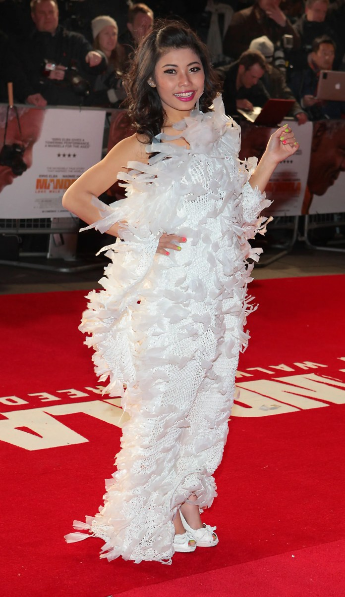 Ta Naw Naw models her creation Say Mo Wah made out of White Plastic Bags at the Royal London Premiere for recycled Fashion Competition Junk Kouture proudly supported by European Recycling Platform and Bank Of