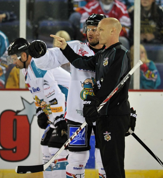 28/8/14: Steve Thronton, coach of the Belfast Giants talks to Adam Keefe, Captain of the Giants during a Season 15 launch night and fans open training session at the Odyssey Arena, Belfast. Picture: Michael Cooper
