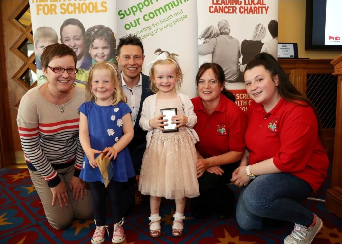 Little Ones Nursey School, Downpatrick pupils, Orla Ritchie, Charlotte Holland and teachers Anne Sweeney and Katie Stringer, picked up their gold award from CentraÕs Nikki McDowell and CitybeatÕs Stephen Clements.