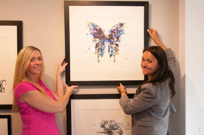 Noeleen McErlane from local charity Pretty 'n' Pink and artist Kathryn Callaghan install artworks from over ten local artists exhibiting at Canvas Gallery Stranmillis between 10-13th June raising funds and awareness for the breast cancer charity.