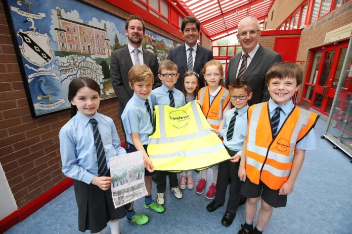 Waringstown Primary School Transport Minister Danny Kennedy announced the winners of the recent Travelwise NI 'My Walk to School' competition.  Fifteen schools from across Northern Ireland were named as the winners in the sustainable transport initiative which took place during Walk to School Week 2015. Schools in Northern Ireland registered to take part in Walk to School Week and all primary schools were asked to encourage pupils, parents and teachers to get active and to take part in a competition to be in with the chance of winning high Viz vests for all pupils in the school.