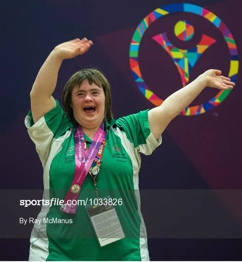 Team Ireland's Lorraine Hession, a member of Team South Galway, from Turloughmore, Co Galway, celebrates after being presented with her 4th place ribbon for her swim in the AQ 100M Freestyle Division F14