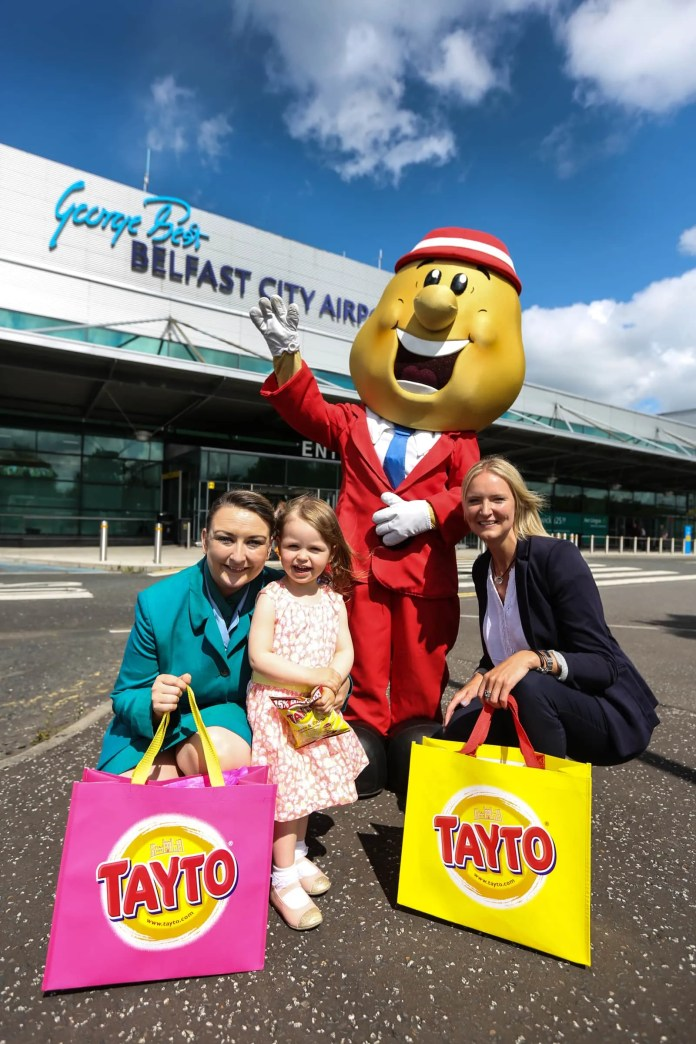 Jo-Anne Taylor, Aer Lingus, passenger Ella McGovern, age 2 and Andrea Hunter, Business Development Manager for Aer Lingus.