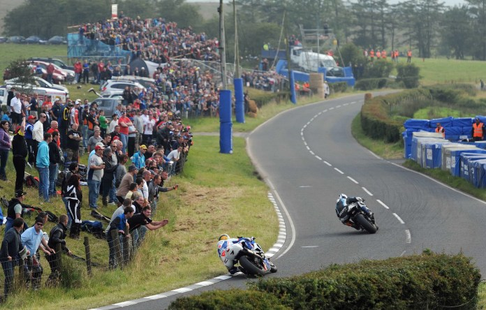 PACEMAKER, BELFAST, 10/8/2012: Michael Dunlop (McAdoo/Hunts Honda) leads Guy Martin (Tyco Suzuki) through Quarry Bends in the second Superbike race at the Ulster Grand Prix today. PICTURE BY STEPHEN DAVISON