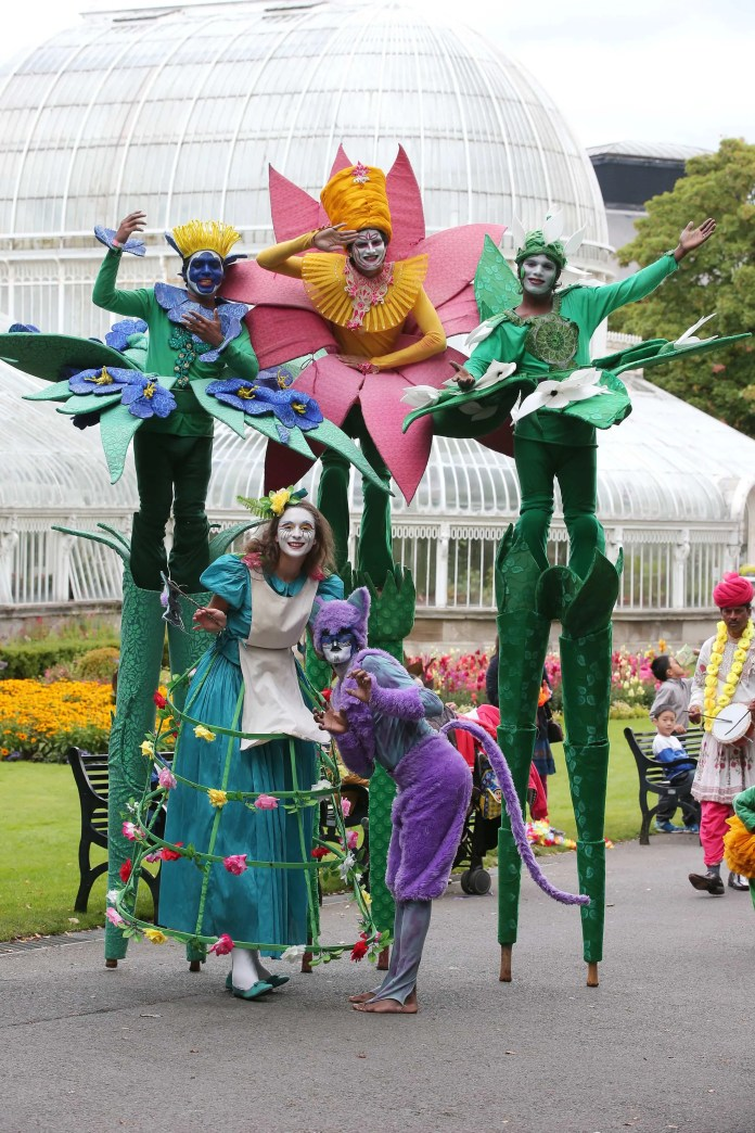 30 August 15 - Picture by Darren Kidd / Press Eye. Magical Mela Hits the Right Notes. For the ninth year in succession Belfast Mela transformed Botanic Gardens to create a unique global get-together filled with music, dance, food, fashion, cuisine and crafts. The dazzling day of diversity held over 25,000 visitors spell bound as they joined in Northern Ireland's largest celebration of world culture.  Organised annually by award winning ArtsEkta the party got off to a magnificent start with a massive carnival procession featuring a spectacular 16ft high Dhol drumming puppet and the Province's first professionally trained group of Dhol drummers in Ireland – giving audiences a drum-believable musical experience. Specially commissioned carnival creations, scores of community participants, musicians and dancers from around the world added colour and impact leading audiences into the heart of magnificent Mela. From babies in buggies to grand and great grandparents the unique global get-together had the whole park bouncing!  A new addition to this year's Mela, Little Bollywood, was specially created for babies, toddlers and young children – under the expert direction of the South Asian Dance Group they soon had the adults dancing, wiggling their fingers and bouncing alongside the wee ones! A constant crowd-pleaser was the Fantasy Forest where a garden of flowers magically came to life telling the story of the fantasy world of Alice through the Looking Glass. World music and dance filled the stages and brought crowds to their feet in appreciation while the sights, smells sounds and tastes of the great big beautiful world combined to makes this year's Mela a kaleidoscope of wonderful images making it a unique and memorable occasion for all those who shared the Mela experience. Issued on behalf of Belfast Mela By Future Image For further information contact Sally Gardiner on 02890423314 or 07768428820 Email: sgardiner@futureimage.co.uk