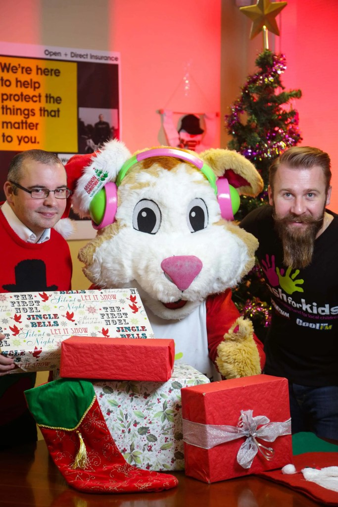Open+Direct branches will be acting as 'drop off' points as part of the Mission Christmas appeal. Pictured from left Alan Hayward, Open+Direct Belfast branch manager, Cash for Kids mascot Courage the Cat and Cash for Kids Regional Manager Darren Fowler.