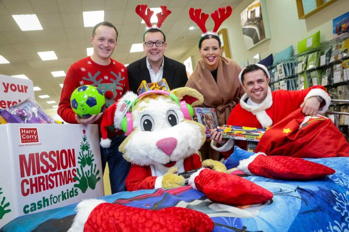 Launching Mission Christmas are, from left, Gary Myles, Downtown Radio, Mark Corry of Harry Corry, Rebecca McKinney and Pete Snodden, Cool FM, with the Cash for Kids mascot Courage the Cat!