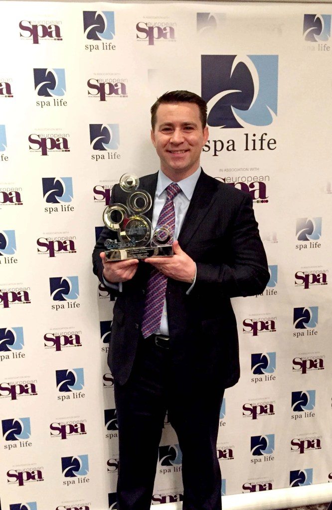 Roe Park Resort Golf & Spa Manager Terry Kelly with the Good Spa Guide Award for Best Spa in Northern Ireland.