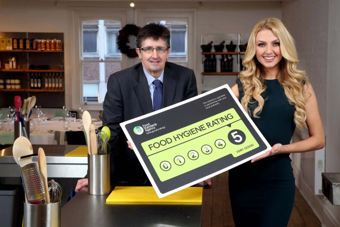 Press Eye Ltd Wednesday 9th December 2015 Photographer Darren Kidd / Press Eye FOOD HYGIENE RATING BILL GIVEN THE GREEN LIGHT AT STORMONT: Pictured is the Head of Local Authority Policy and Delivery at the FSA in NI, Michael Jackson and model, Meagan Greene celebrating the passing of the Food Hygiene Rating Bill in the NI Assembly, which will see the mandatory display of the Food Hygiene Rating stickers in Northern Ireland food businesses from October 2016. For more information on the Food Hygiene Rating Scheme visit, http://ratings.food.gov.uk/ or for further updates from the FSA in NI join their conversations at facebook.com/FSAInNI or Twitter @FSAinNI.