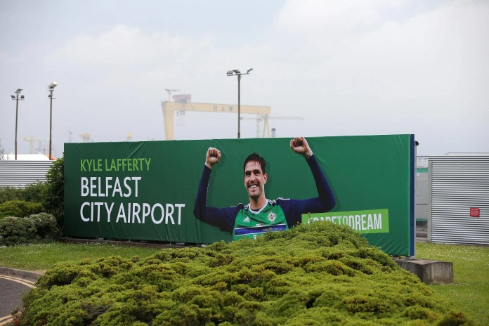 Press Eye - Belfast - Northern Ireland -  12th June 2016 -  George Best Belfast City Airport displays its support for Northern Ireland at the Euros by changing its name for the day in honour of the team's star striker.  For one day only (Sunday, 12th June), the airport has become the Kyle Lafferty Belfast City Airport in a historic move ahead of Michael O'Neill's men kicking off their Euro 2016 campaign against Poland in Nice this evening.  Signage at the City Airport's terminal roof and at the entrance has been changed to honour the star striker, while the branding on the airport's website and digital platforms has also been amended. Photo by Kelvin Boyes / Press Eye