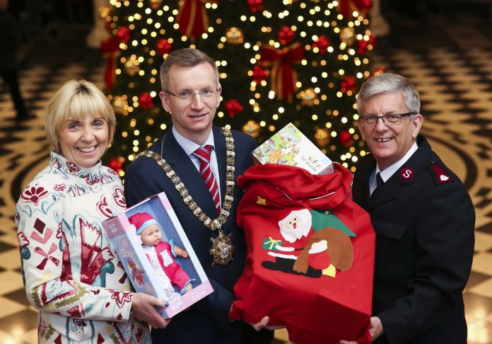 Delivering happiness to local families: Two local charities have teamed up once again to make Christmas brighter for thousands of children and families across Northern Ireland. Belfast's Lord Mayor, Alderman Brian Kingston joined Pauline Brown, Regional Manager for St Vincent de Paul and Major Elwyn Harries, Leader of the Salvation Army in Ireland to launch the 37th annual Family Appeal at Belfast City Hall. 50,000 gifts were distributed to local families in need last year and the charities are appealing to the public to support the 2016 Appeal by picking up an extra present to ensure no child goes without this Christmas. The unwrapped toys can be dropped off at Tesco, Gordon's Chemist or First Trust bank or at any branch of the Salvation Army or SVP.