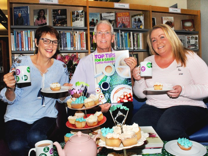 Libraries NI staff get ready for Macmillan Coffee Morning