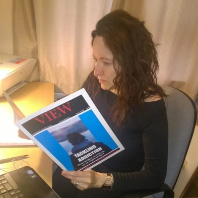 Paid Subcriber promotion pic Bridget Meehan reading VIEW magazine