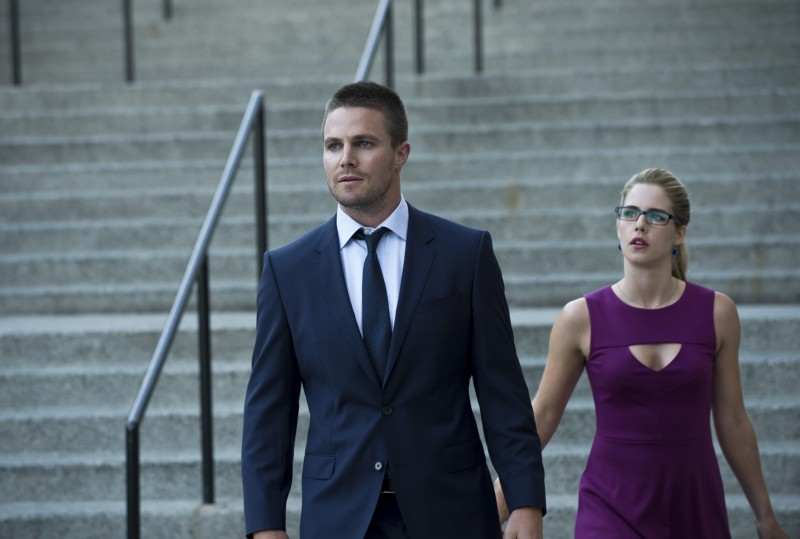 "Arrow -- ""The Calm"" -- Image AR301b_0105b -- Pictured (L-R): Stephen Amell as Oliver Queen and Emily Bett Rickards as Felicity Smoak -- Photo: Cate Cameron/The CW -- © 2014 The CW Network, LLC. All Rights Reserved."