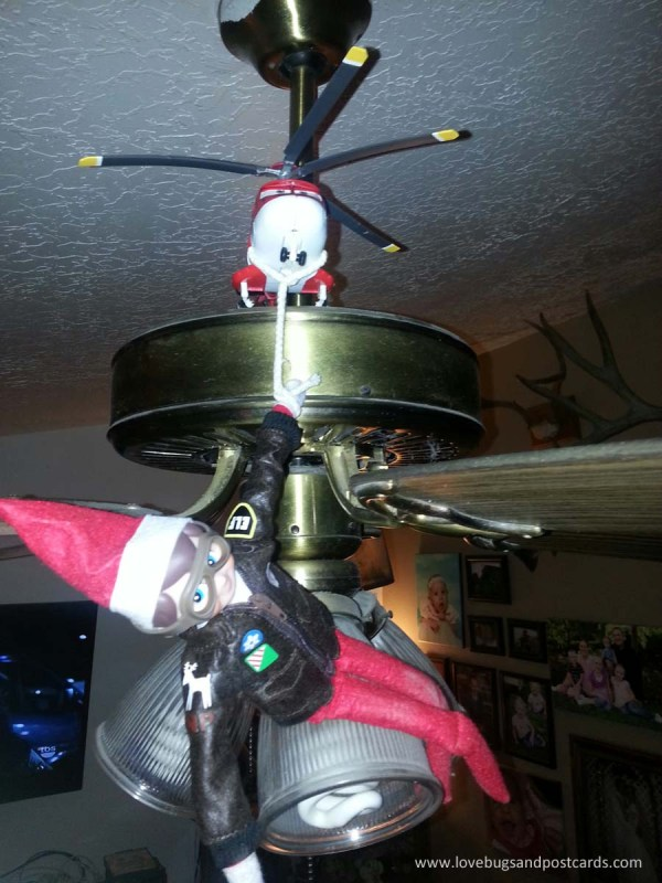 Elf on the Shelf Ideas - Elf Hanging from a Helicopter