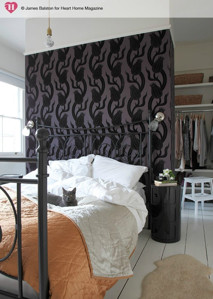 When your bedroom is small, large storage pieces can take up valuable floor space that could be used for other items or left open to give the room a more spacious feel. Instead of keeping a large armoire, tall chest of drawers or wide dresser in your actual bedroom, place it in your closet where it is out of the way.
