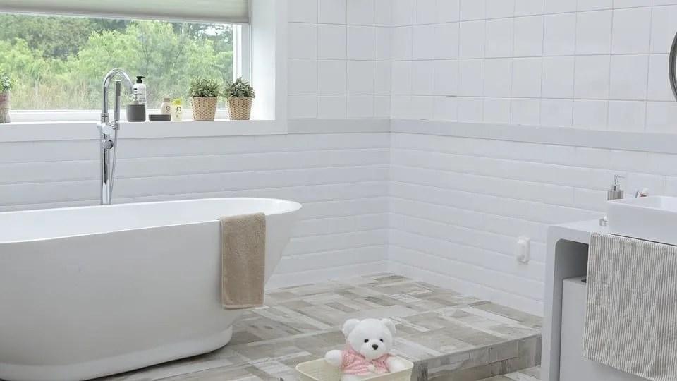 White tiled bathroom with waterproof laminate flooring