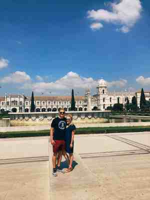 Couple in front of Jeronimos Monastery in Lisbon
