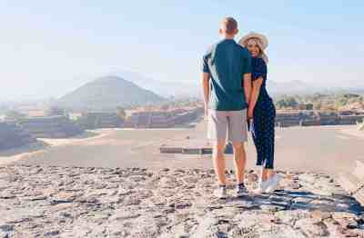 Couple posing on top of the pyramid of the moon at the Teotihuacan archaeological site