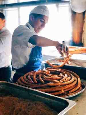 Man cooking El Moro churros