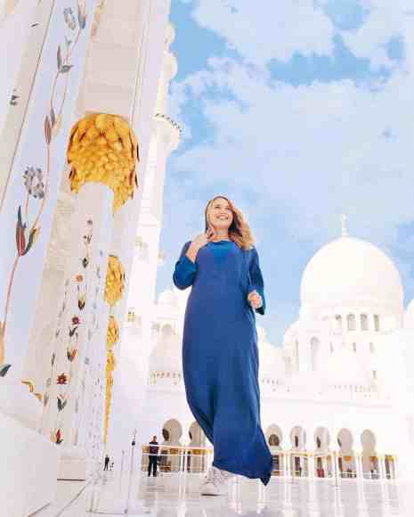 Woman posing at Sheikh Zayed Grand Mosque, one of the top things to do in Dubai.