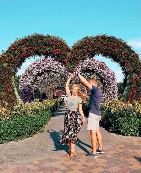Twirling at the heart arches at Dubai Miracle Garden, one of the top things to do in Dubai.