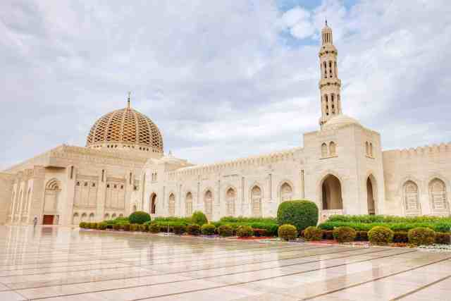 Outside Sultan Qaboos Grand Mosque, one of the top things to do in Oman.