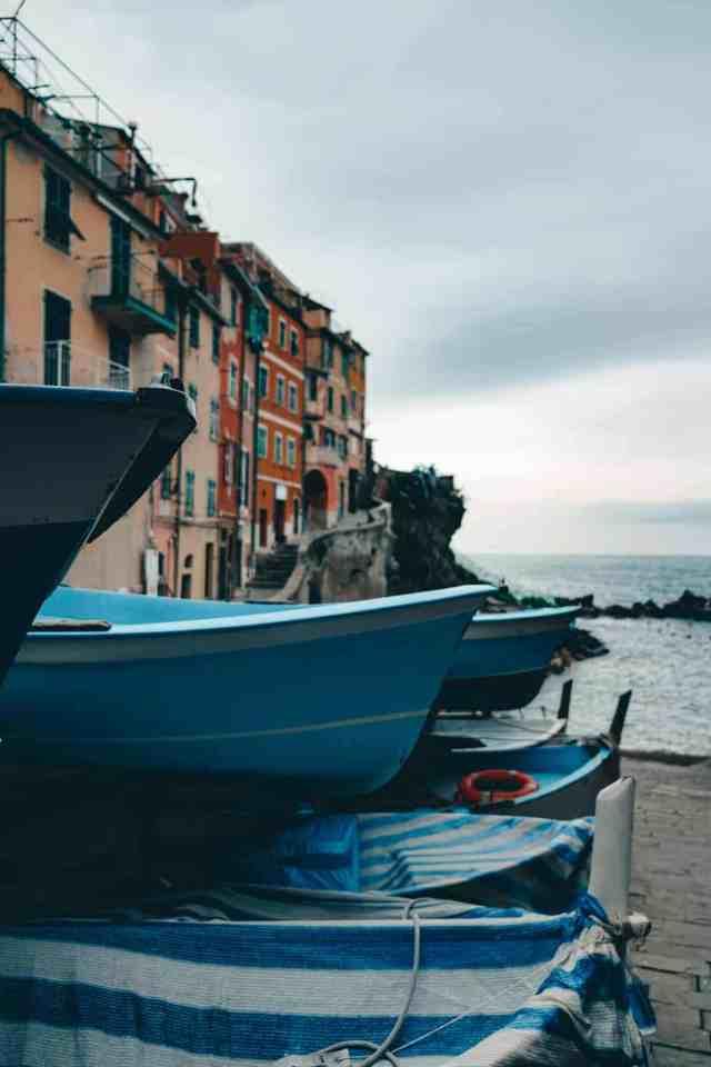 Blue boats in Riomaggiore harbour in Cinque Terre