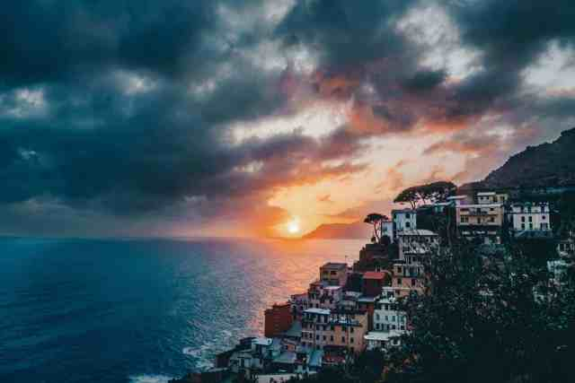 Colorful sunset over Riomaggiore, one of the top things to do in Cinque Terre