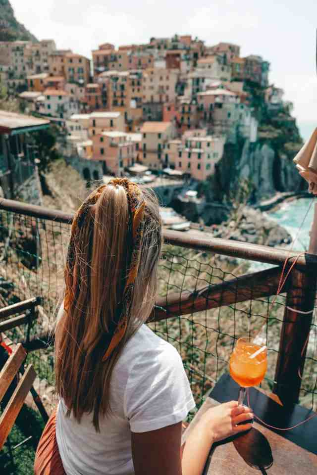 Enjoying a drink overlooking Manarola, one of the top things to do in Cinque Terre