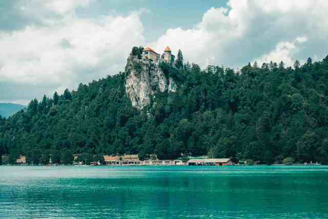 Bled Castle on top of the cliffside in Bled Slovenia