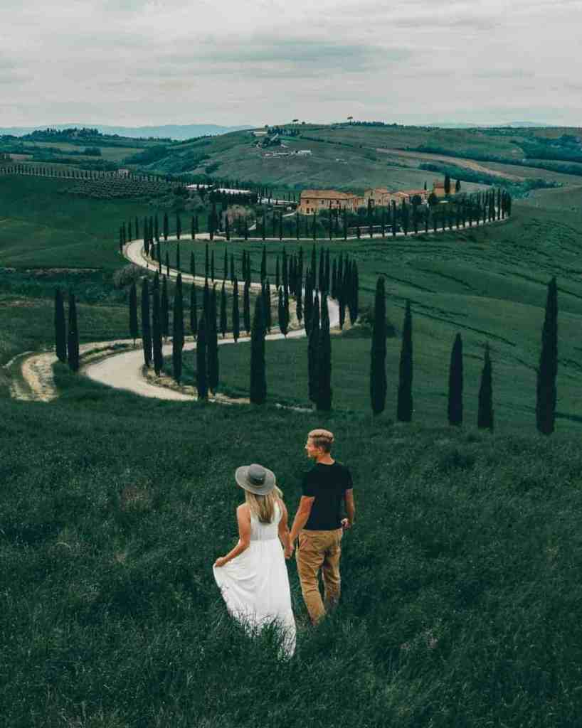 Aerial view of a couple running through the rolling hills of Tuscany, shot with DJI Mavic 2 Pro